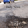 Salisbury:<br /> A car passes pot holes at Toll Road at High Street in Salisbury as the motorists' nuisances are making their annual appearance. Dark pavement absorbing heat from the sun melts snow that seeps into cracks and expands when temperature refreeze the roadways.<br /> Photo by Bryan Eaton/Newburyport Daily News Friday, January 23, 2009