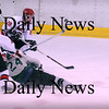 Haverhill:<br /> Pentucket's Matt McCarthy (24) collides with Amesbury's Zachary Pizzo (4) and Nicholas Forni (19) while shooting the puck towards the Amesbury goal Saturday night in Haverhill.<br /> Photo by Bryan Eaton/Newburyport Daily News Saturday, January 10, 2009