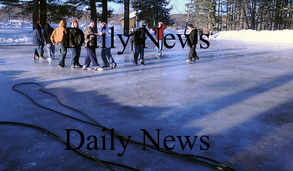Amesbury:<br /> No teenagers were skating on the new ice skating rink at Amesbury Town Park, though a few were sliding along on their street footwear. The rink was cleaned of snow Monday morning and water was sprayed on to create a smoother layer of ice.<br /> Photo by Bryan Eaton/Newburyport Daily News Monday, January 12, 2009