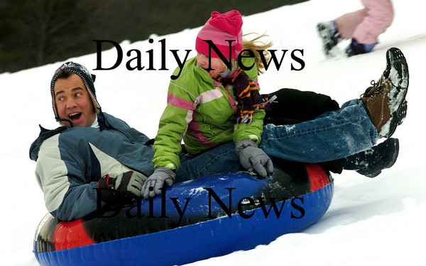 Amesbury:<br /> Bill Williams and his daughter Emily, 9, slide down the hill at Woodsom Farm on Friday afternoon as winter sports got a boost from Tuesday's snowstorm. The Brentwood, N.H. residents used to live in Amesbury and would always go to the popular sledding spot.<br /> Photo by Bryan Eaton/Newburyport Daily News Friday, January 02, 2009