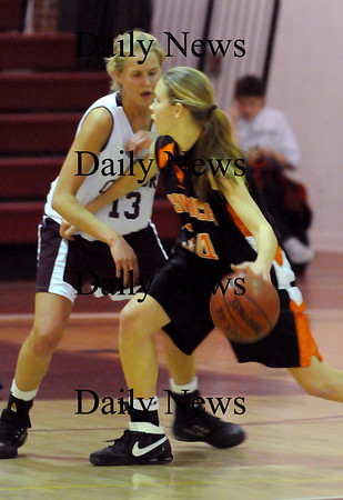 Newburyport:<br /> Newburyport's #13 (not in roster) defends against Ipswich's Hannah O'Flynn.<br /> Photo by Bryan Eaton/Newburyport Daily News Friday, January 23, 2009