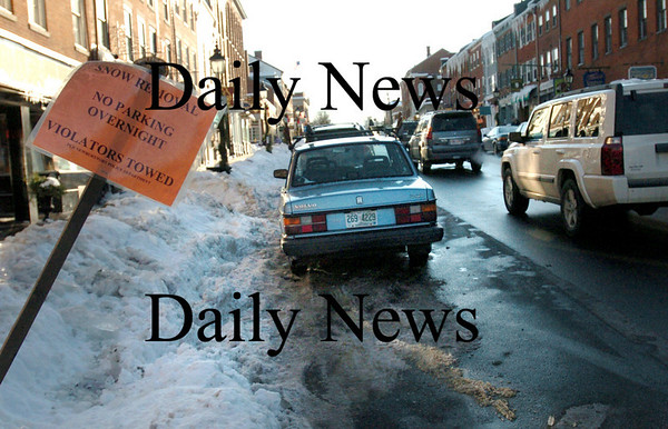 Newburyport:<br /> Signs here in downtown Newburyport and in parts of downtown Amesbury warn residents to not park overnight as crews will be removing the snow to be clear for any future storms.<br /> Photo by Bryan Eaton/Newburyport Daily News Wednesday, January 21, 2009
