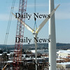 Newburyport:<br /> The rotor to the wind turbine being constructed at Mark Richey Woodworking was hoisted into place late Monday morning.<br /> Photo by Bryan Eaton/Newburyport Daily News Monday, January 12, 2009