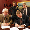Newburyport: Mayor John Moak is one of the signers of a Memorandum of Understanding in which the parties involved work to ensure a safe school environment. Also signing, from left, Essex County DA Jonathan Blodgett, Newburyport Police Marshall Thomas Howard, and Newburyport School Superintendent Kevin Lyons.