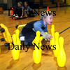 Newbury:<br /> Nathan Davies, 7, laughs as he falls off his roller scooters while playing human bowling. He was in Anna Molesso's physical education class at Newbury Elementary School on Thursday.<br /> Photo by Bryan Eaton/Newburyport Daily News Thursday, January 15, 2009