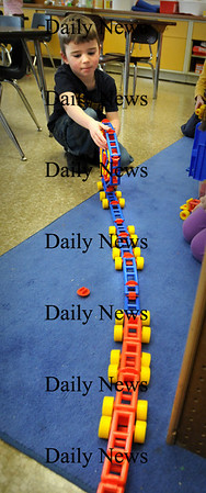 "Newburyport:<br /> Thomas Childs, 5, rolls up his ""giant ladder with wheels"" made with Mobilos in Linda Gershuny's kindergarten class at the Brown School on Tuesday afternoon. The children are learning the letter ""m"" and were playing with different toys or games that begin with the letter.<br /> Photo by Bryan Eaton/Newburyport Daily News Tuesday, January 13, 2009"