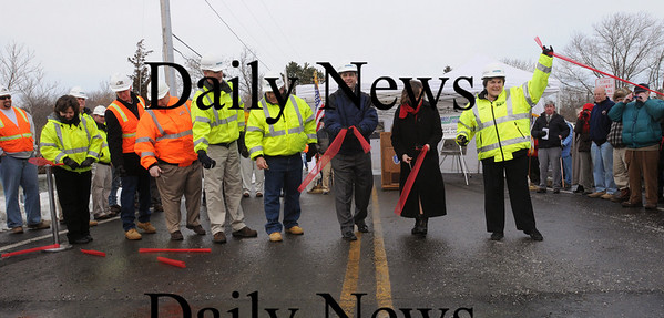 Newbury:<br /> State representative Harriet Stanley, right, raises the ribbon in glee as she, senator Bruce Tarr, and other official participated in a ceremony for the opening of the Route 1A bridge in Newbury.<br /> Photo by Bryan Eaton/Newburyport Daily News Monday, January 05, 2009