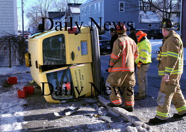 Newburyport:<br /> A Newburyport Water Department truck was hit by a car and knocked on its side at the bottom of Marboro Street at Water Street on Friday afternoon.<br /> Photo by Bryan Eaton/Newburyport Daily News Friday, January 09, 2009