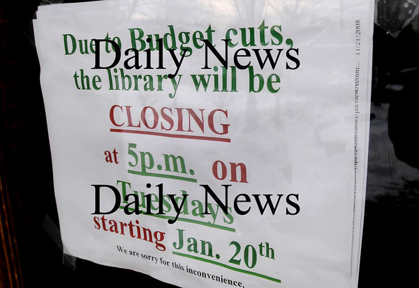 Amesbury:<br /> The sign on the front door of Amesbury Public Library sums up the situation there.<br /> Photo by Bryan Eaton/Newburyport Daily News Thursday, January 22, 2009