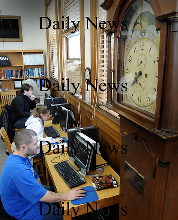 Amesbury:<br /> With only three computers at Amesbury Public Library with online access, there's usually a wait to use them. Using them on Thursday afternoon, front to back, Jason Locke, Elizabeth Battle and Rory McCarron all of Amesbury.<br /> Photo by Bryan Eaton/Newburyport Daily News Thursday, January 22, 2009