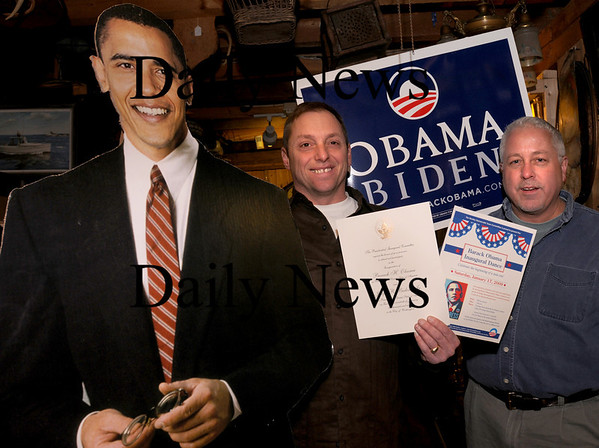 Rowley:<br /> Next to a cut-out of Barack Obama, Bob Cianfrocca, Dance Committee Chairman and Curt Bryant, vice president of the Rowley Town Democratic Committee show a poster for the group's Inaugural Dance, the back printed with a copy of the official invitation. The group is holding the fundraiser tomorrow night at the Carriage Pines, formerly the Rowley Country Club.<br /> Photo by Bryan Eaton/Newburyport Daily News Thursday, January 15, 2009