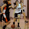 Newburyport:<br /> Newburyport's Cassaundra Davis heads down court as Ipswich's Audrey Shaughnessy moves in to cover.<br /> Photo by Bryan Eaton/Newburyport Daily News Friday, January 23, 2009