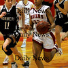 Amesbury:<br /> Amesbury's Whitney Whitlow moves down court past Manchester-Essex players in action last night.<br /> Photo by Bryan Eaton/Newburyport Daily News Friday, January 02, 2009