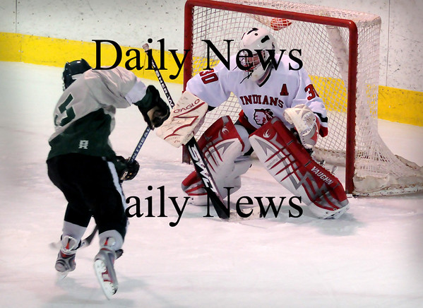 Haverhill:<br /> Amesbury goalie Matthew Irwin braces as Pentucket's John Gavin makes an unsuccesful shot on net in Haverhill on Saturday night.<br /> Photo by Bryan Eaton/Newburyport Daily News Saturday, January 10, 2009