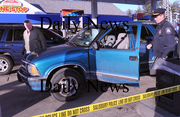 Salisbury:<br /> Salisbury Police Chief David L'Esperance, left, and Newburyport Marshall Thomas Howard check out the Chevy blazer that the alleged robber of the Eastern Bank on Story Avenue in Newburyport used to get away Friday afternoon. Police chased the suspect to the One Stop Sunoco Station on Route 110 in Salisbury where he was apprehended.<br /> Photo by Bryan Eaton/Newburyport Daily News Friday, January 09, 2009