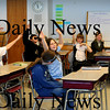 "Amesbury:<br /> Students in Karen Brannelly's fifth grade homeroom class at Amesbury Middle School sway their arms to Aretha Franklin's singing of ""My Country 'Tis of Thee"" while waiting for President Barack Obama to take the Oath of Office.<br /> Photo by Bryan Eaton/Newburyport Daily News Tuesday, January 20, 2009"