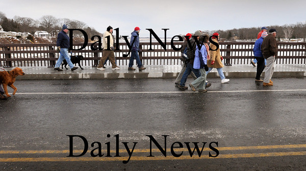 Newbury:<br /> Citizens walk over the new Route 1A bridge over the Parker River in Newbury before the bridge was open to vehicular traffic after a brief ceremony yesterday afternoon.<br /> Photo by Bryan Eaton/Newburyport Daily News Monday, January 05, 2009