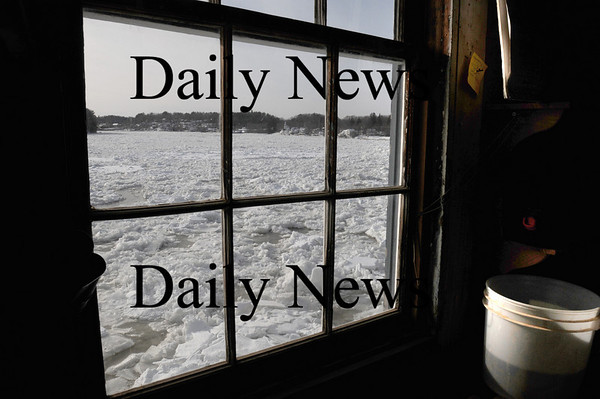 Amesbury:<br /> The Merrimack River is covered with compacted ice all along Point Shore down past Deer Island from a view inside Lowell's Boat Shop looking upriver. Some think that could be the reason few bald eagles have been seen in the area, not having access to open water for grabbing fish. Photo by Bryan Eaton/Newburyport Daily News Wednesday, January 14, 2009