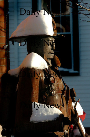 Amesbur: The coating of snow atop the statue of a firefighter in front of the Amesbury Fire Station may not melt soon as temperatures are forecast to become more frigid as the week goes on.<br /> Photo by Bryan Eaton/Newburyport Daily News Monday, January 12, 2009