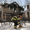 Amesbury:<br /> Amesbury firefighters wrap up their hoses at the scene of a single family home was destroyed by fire early Monday morning on Birch Meadow Road in Amesbury on Lake Attitash. Firefighters had a tough battle fighting the fire in extreme cold and dealing with problems getting water to the scene.<br /> Photo by Bryan Eaton/Newburyport Daily News Monday, January 26, 2009