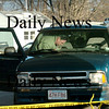 Salisbury:<br /> Salisbury Police Chief David L'Esperance, in vehicle, and Newburyport Marshall Thomas Howard check out the Chevy blazer that the alleged robber of the Eastern Bank on Story Avenue in Newburyport used to get away Friday afternoon. Police chased the suspect to the One Stop Sunoco Station on Route 110 in Salisbury where he was apprehended.<br /> Photo by Bryan Eaton/Newburyport Daily News Friday, January 09, 2009
