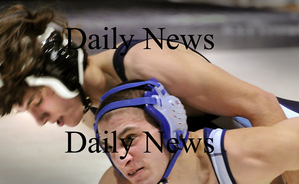 Byfield: Triton wrestler Cody Miller, left, tries to flip Wilmington's Tony Valente in the 145 pound class which Miller won.  Photo by Bryan Eaton/ Newburyport Daily News   Thursday January 29, 2008.