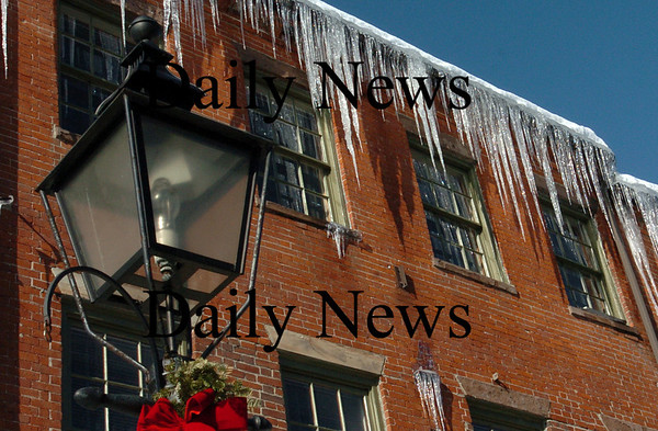 Newburyport:<br /> Icicles, some several feet long, hang from the roofs of buildings along Newburyport's State Street.<br /> Photo by Bryan Eaton/Newburyport Daily News Wednesday, January 21, 2009