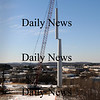Newburyport:<br /> The giant crane at Mark Richey Woodworking hoists the third section of the wind turbine being constructed there this week.<br /> Photo by Bryan Eaton/Newburyport Daily News Tuesday, January 06, 2009
