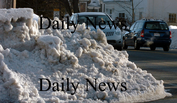 Newburyport: Motorists have to be extra careful about pulling into traffic as record snowfalls have created huge mounds at some intersections blocking views, here at the top of Woodland Street at High Street in Newburyport.