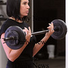 Amesbury:<br /> Amber Ryan Shelley lifts weights at the Fuel Training Studio on Cedar Street in Amesbury.<br /> Photo by Bryan Eaton/Newburyport Daily News Thursday, January 08, 2009