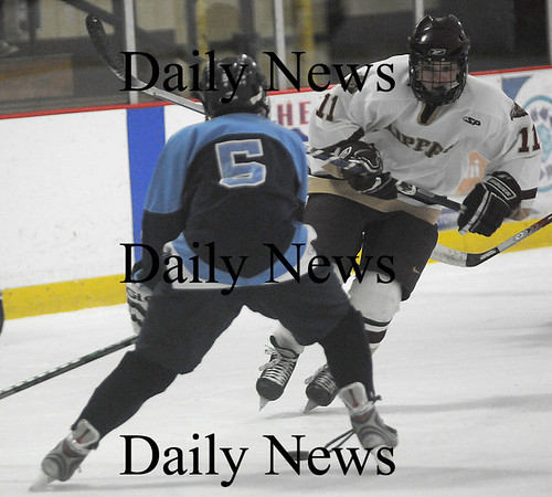 Newburyport: Newburyport Ryan Cutter makes a move on a Franklin player during their game Monday at the Graf Rink in Newburyport. photo by Jim Vaiknoras/ Newburyport Daily News January 19, 2009