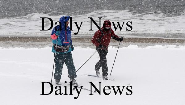 Newbury: Paul Prisby of Byfield and Ken Petrucci of Newburyport cross-country ski along the beach on Plum Island Sundau afternoon. photo by Jim Vaiknoras/ Newburyport Daily News. January 18, 2009