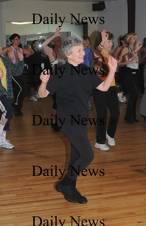 Newburyport:Gloria Papert works out in Susan Smith's Zumba class at the Fitness Factory.photo by Jim Vaiknoras/Newburyport News Saturday January 10, 2009