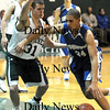 West Newbury: Georgetown's Julio Colon makes a move on Pentucket's Connor Harrison during their game at Pentucket Tuesday night.photo by JIm Vaiknoras. Tuesday January 13, 2009