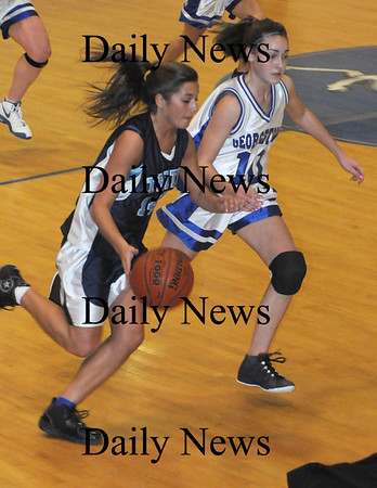 Georgetown: Triton's Caleigh Mehan is guarded by  Georgetown's Morgan Gott during their  game at Georgetown Tuesday night. photo by Jim Vaiknoras/ Newburyport Daily News. Tuesday January 6, 2008