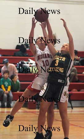 Amesbury: Amesbury's Gabby Magnifico fights for a rebound with North Andover's Tori Pierce during their game at Amesbury Monday. photo by Jim Vaiknoras/ Newburyport Daily News January 19, 2009