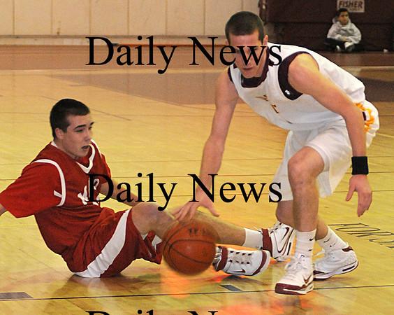 Newburyport: Newburyport's Joe Clancy grabs a loose ball against Masco at Newburyport Friday night.photo by Jim Vaiknoras/Newburyport Daily News. Friday January 9, 2009