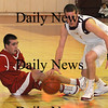Newburyport: Newburyport's Joe Clancy grabs a loose ball against Masco at Newburyport Friday night.photo by Jim Vaiknoras/Newburyport Daily News. Friday January 9, 2009