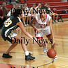 Amesbury: Amesbury'sWhitney Whitlow drives to the basket against  North Andover during their game at Amesbury Monday. photo by Jim Vaiknoras/ Newburyport Daily News January 19, 2009
