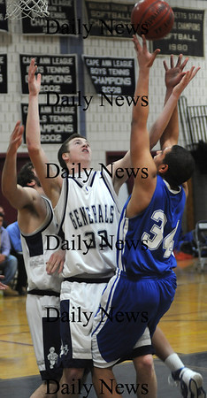 Hamilton:Georgetown's Julio Colon fights for a rebound with  Hamilton-Wenham's Matt Cook during their game at Hamilton Friday night.photo by Jim Vaiknoras/Newburyport Daily News january 30, 2009