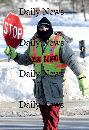 NEWBURYPORT: Bob Bruce is all bundled up as he helps students cross Toppans Lane on a cold Friday afternoon.photo by Jim Vaiknoras /Newburyport Daily News. Friday January, 16, 2009