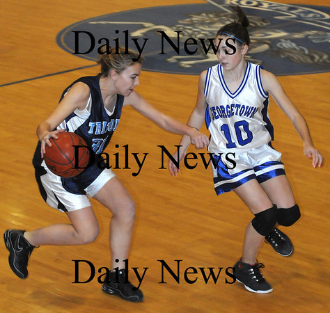 Georgetown: Triton's Jen Rock is guarded by  Georgetown's Morgan Gott during their  game at Georgetown Tuesday night. photo by Jim Vaiknoras/ Newburyport Daily News. Tuesday January 6, 2008