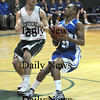 West Newbury: Georgetown's Jaymie Spears makes a move on Pentucket's Chris Modlish during their game at Pentucket Tuesday night.photo by JIm Vaiknoras. Tuesday January 13, 2009