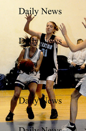 Georgetown:  Georgetown's Gina DeGenova drives on Triton's Jen Rock during their  game at Georgetown Tuesday night. photo by Jim Vaiknoras/ Newburyport Daily News. Tuesday January 6, 2008