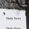 Amesbury: A snowboarder walks back up the hill at Woodsom Farm in Amesbury Sunday morning.photo by Jim Vaiknoras/Newburyport Daily News, Sunday January 11, 2009