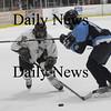 Newburyport: Newburyport David Cusack skates past a Franklin player during their game Monday at the Graf Rink in Newburyport. photo by Jim Vaiknoras/ Newburyport Daily News January 19, 2009