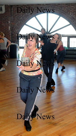 Newburyport: Susan Smith teaches a Zumba class at the Fitness Factory.photo by Jim Vaiknoras/Newburyport News Saturday January 10, 2009
