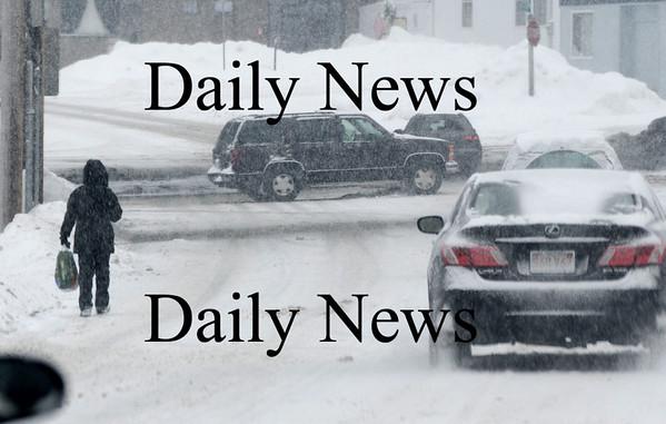 Newburyport: A woman walks through the snow along merrimack Street in Newburyport Suday morning. photo by Jim Vaiknoras/ Newburyport Daily News. January 18, 2009