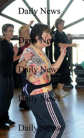Newburyport: Susan Smith teaches a Zumba class at the Fitness Factory.photo by Jim Vaiknoras/Newburyport News Saturday January 10, 2009
