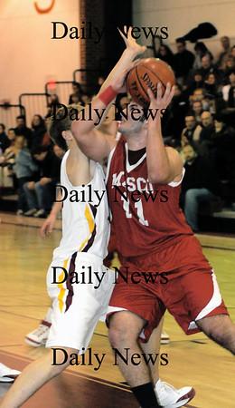 Newburyport: masco's Clay Cleveland fights his way to two points  at Newburyport Friday night.photo by Jim Vaiknoras/Newburyport Daily News. Friday January 9, 2009